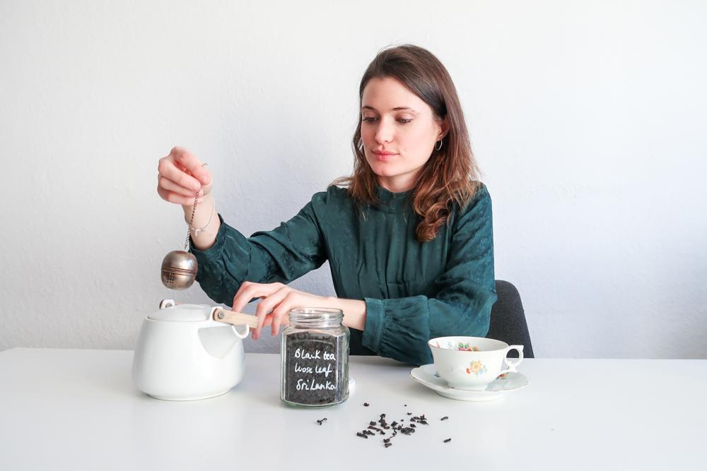 Mia making tea using plastic free tea bags