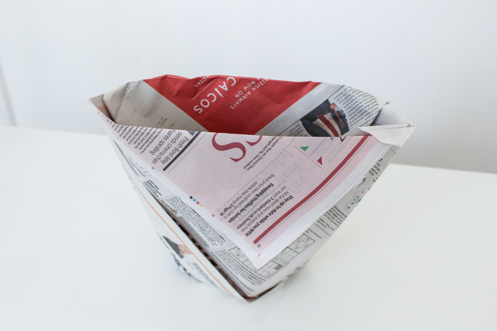 Make a bin liner out of newspaper