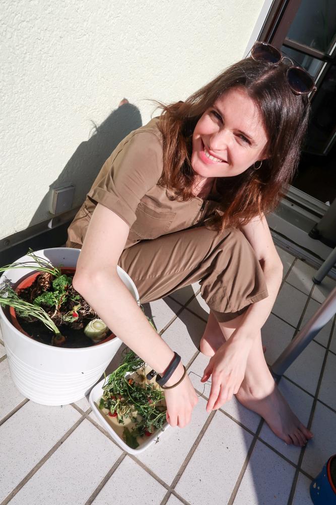 girl planting food scraps to regrow