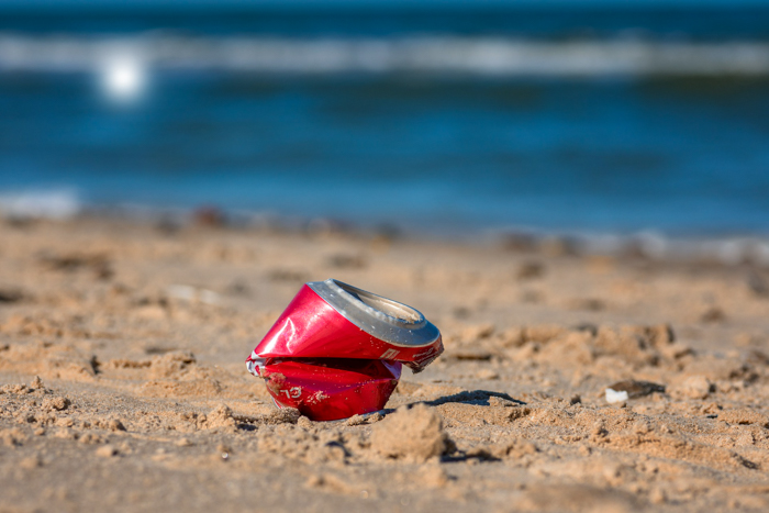 beach clean up Coca Cola bottle