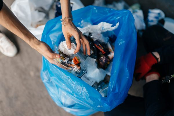 Young woman sorting garbage. Concept of recycling.