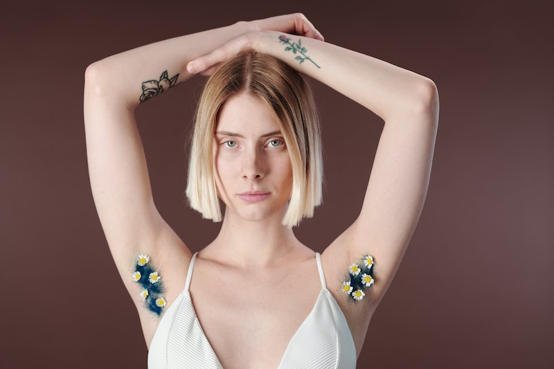woman showing her armpits with flowers in