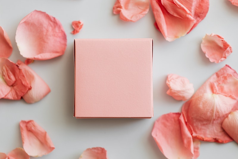 plastic free gift surrounded by rose petals