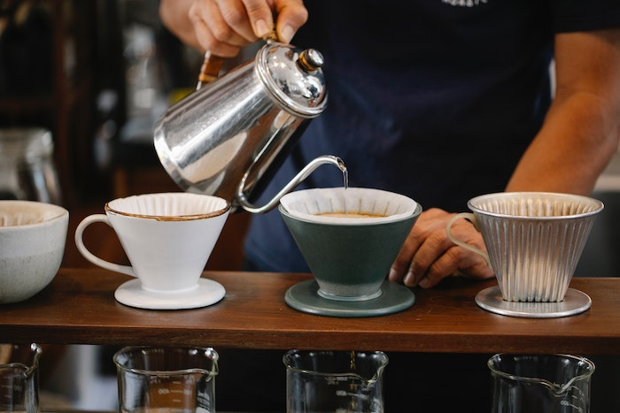 plastic free kettle pouring into coffee cups on a counter