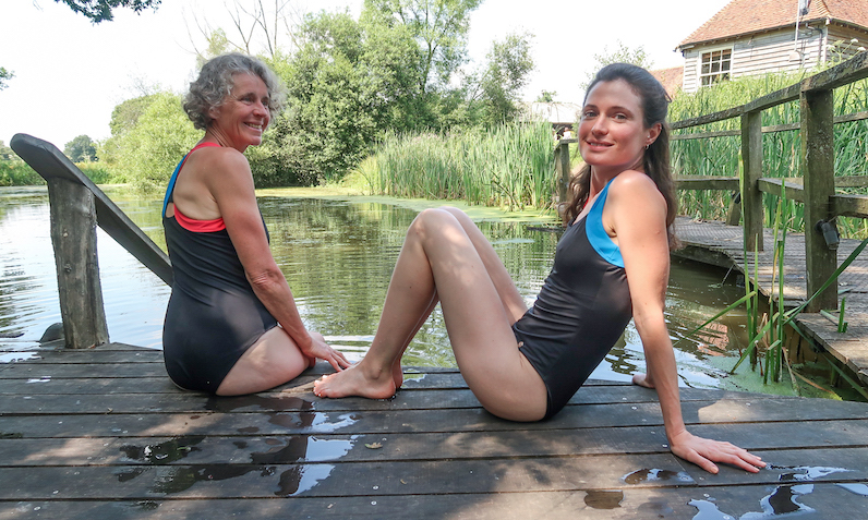 mother and daughter wearing Ruby Moon swimwear by natural swimming pond